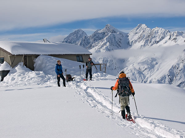 Returning to Caroline Hut after a day's snowshoeing