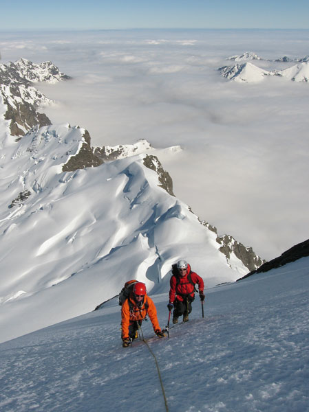 Climbers on the summit ice cap of Mt Sefton.