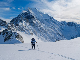 Ski touring in front of the Caroline Face of Mount Cook