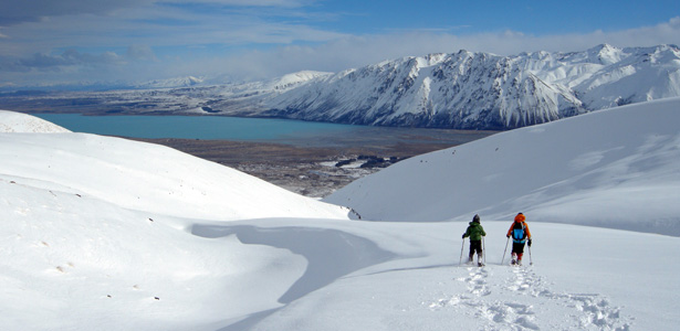 Snow shoeing above Mt. Gerald Stream, overlooking Lake Tekapo.
