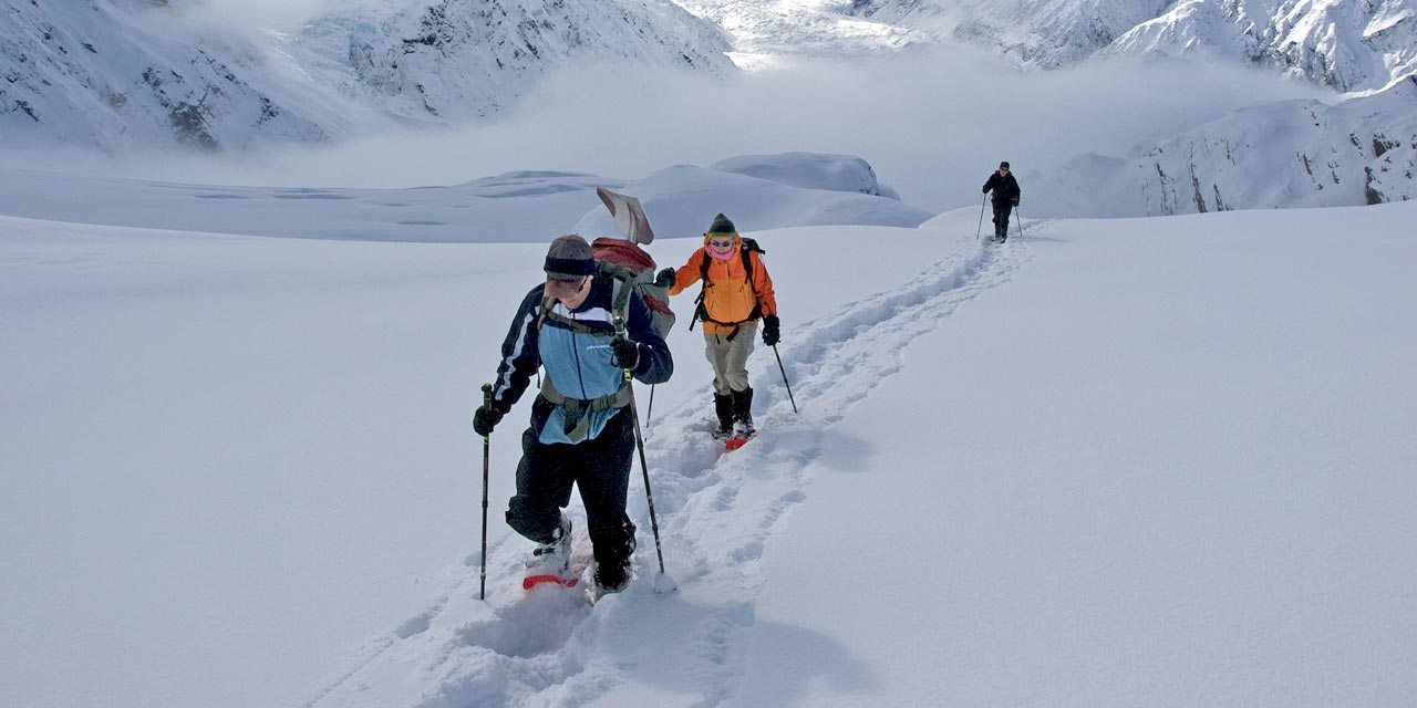 Snowshoers on Kaitiaki Peak above the Ball Glacier