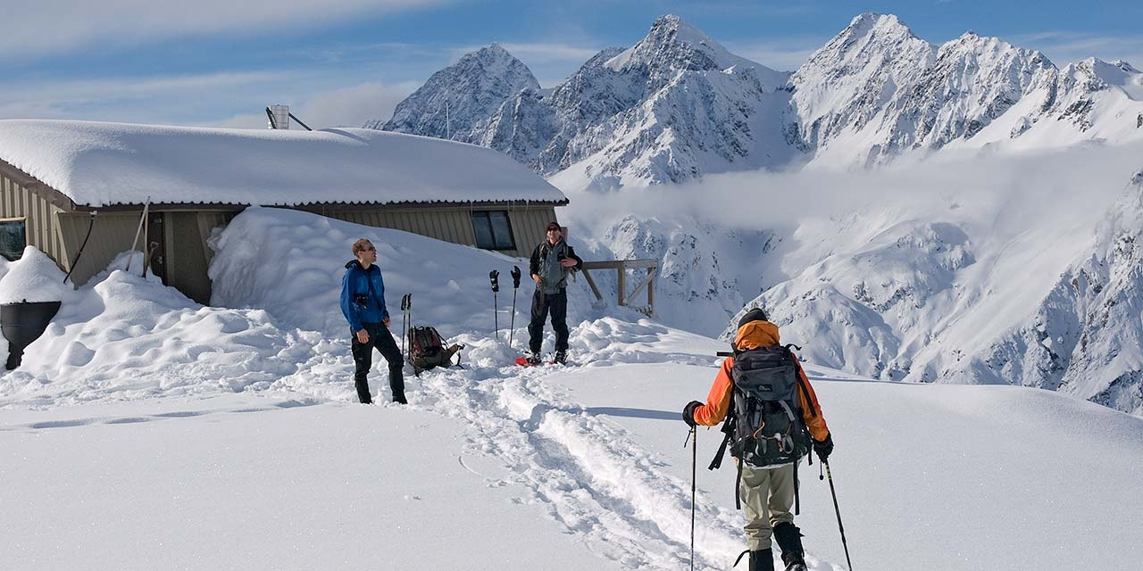 Snowshoers arriving at Caroline Hut